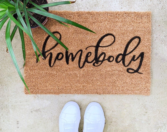 Featured listing image: Hand Lettered Welcome Mat | Homebody Text | Sassy Quote | Outdoor Decor | Front Porch Rug | Outdoor Rug | Calligraphy | Hand Painted
