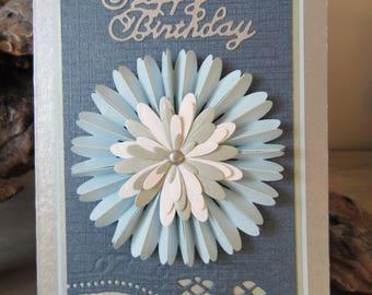 Birthday card. Blue embossed rosette