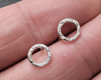 Shimmery silver tiny hoop studs
