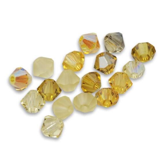 20 Perles Toupies 4mm cristal Swarovski VINTAGE ROSE AB