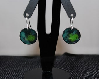 Green toned enameled earrings