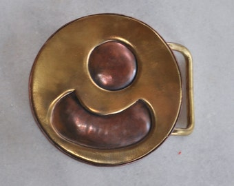 Belt buckle in brass and copper
