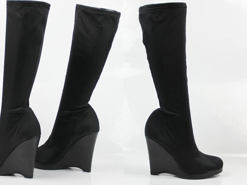 c3a02ab9f315d 90s black neoprene avantgarde futuristic knee high boots | structural wedge  heel | raver techno | US 8.5