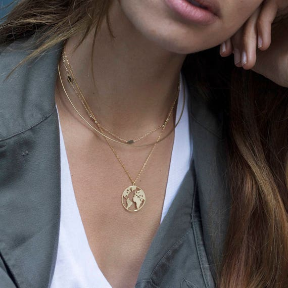 World map necklace globetrotter necklace gold map necklace etsy image 0 gumiabroncs Choice Image