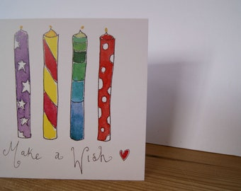 Four candles bright ' Make a wish ' birthday card , blank inside.