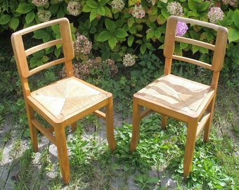 Pair of wooden chairs seat straw