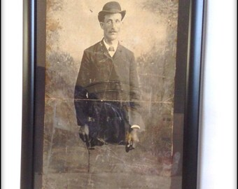 Aged reproduction Victorian picture of half a gentleman in frame.