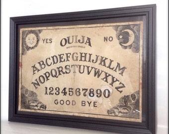 Ouija Board reproduction print in frame