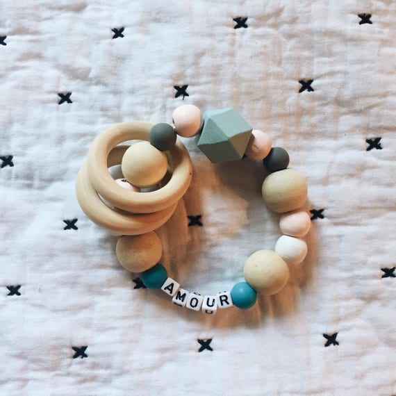 Customizable wooden rattle and silicone and baby teething ring handmade with love in La Rochelle
