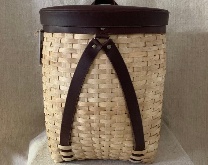 Adirondack basket with leather lid and strap