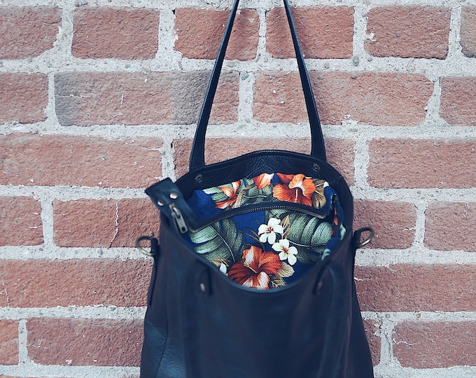 Bag bag with leather shoulder strap, floral printed fabric interior.  Handmade in Quebec