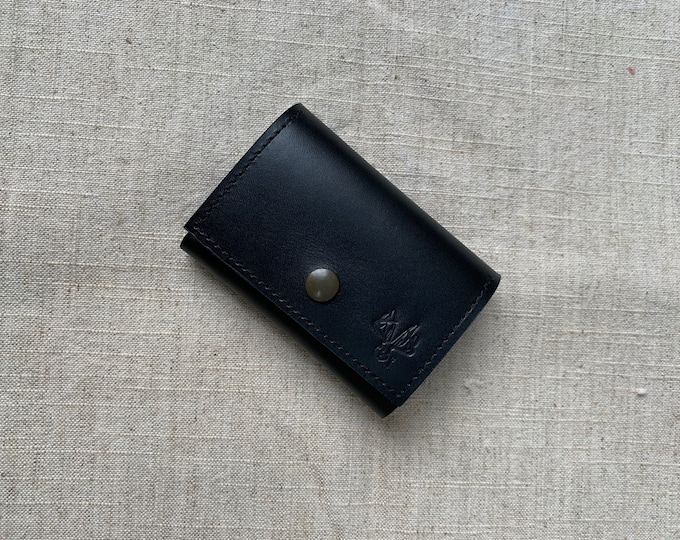 Minimalist black leather wallet and cards