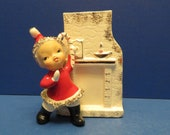 Ucagco Pixie Girl Wearing Santa Suit Holding Candy Cane Candy Cane Holder or Planter - Stands Beside Fireplace w Candle and Clock on Mantle