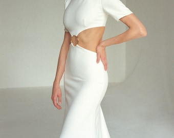 Crepe wedding dress with cut-outs and high neck collar in modern mermaid form fitting silhouette Minimalist short sleeve bridal gown ODELINE