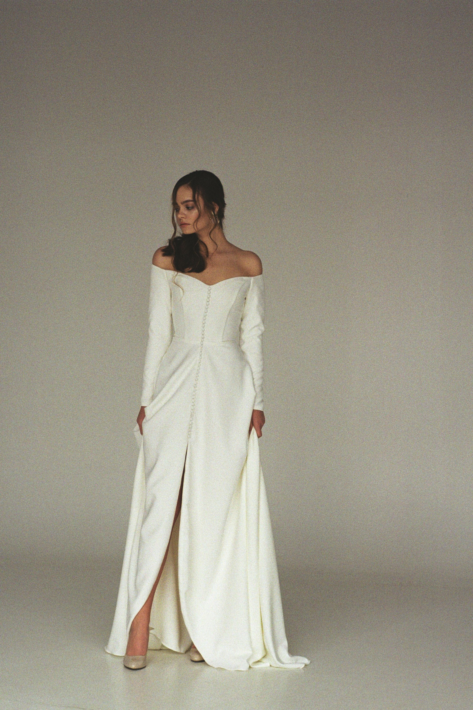 Modern off-shoulder wedding dress with a
