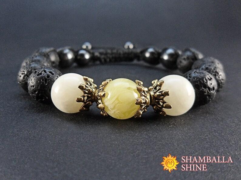 Lava amber and onyx gemstone women bracelet Yellow black image 0