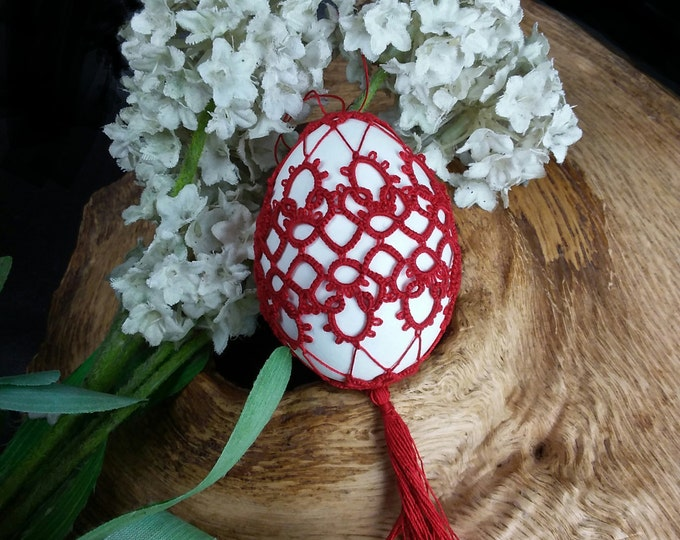 Easter egg decorated with handmade red lace. Ornate real egg Easter ornament. Hanging decor Easter gift