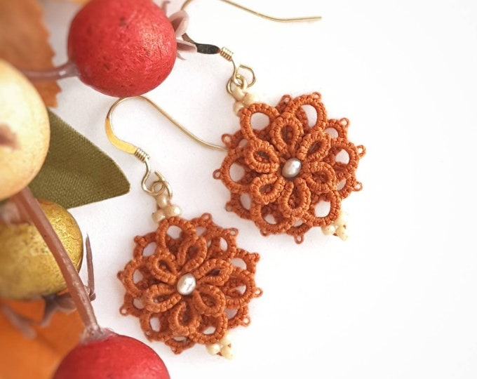 Beaded dangle earrings in burnt orange cotton lace. Autumn flower drop earrings in tatting lace and cream glass beads. Seasonal gift for her