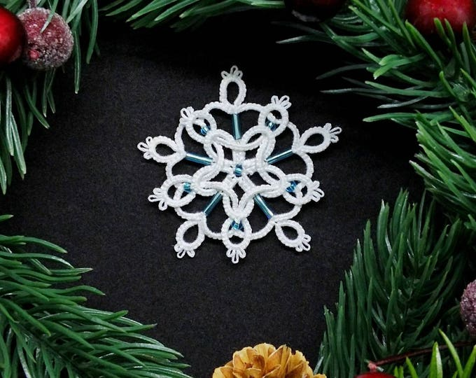 Celtic lace Christmas tree star decoration. Beaded snowflake ornament in white tatting lace. Festive Christmas gift.