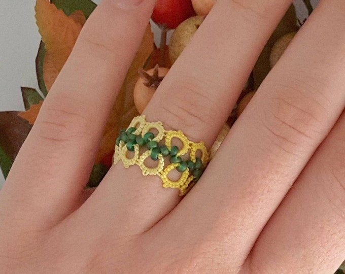 Yellow and green beaded lace ring. Hypoallergic band ring made from cotton tatting lace. Flexible soft ring with green glass beads.