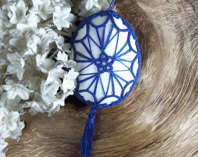Easter egg decorated with blue lace. Handmade tatting lace Easter ornament. Easter ornate egg gift.