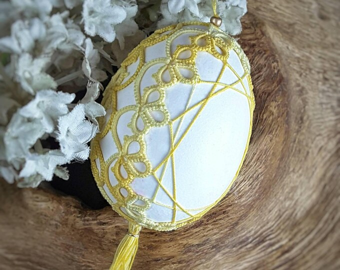 Easter egg decorated with yellow lace. Handmade cotton tatting lace Easter decor. Hanging Easter ornament gift.