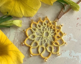 Yellow oval lace pendant with glass beads. Delicate cotton dreamcatcher necklace in summer colours.