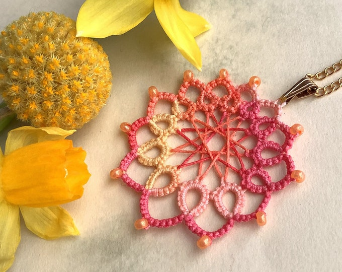 Apricot pink rosette oval pendant with orange beads. Dreamcatcher cotton lace necklace in flower summer colours. Cheerful gift for her