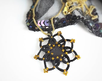Black lace and blue goldstone star pendant. Celestial necklace with cotton lace and gold glass beads. Evening and goth wear. Gift for her