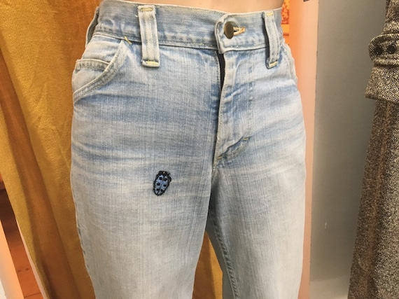 70s Hi Waisted Light Wash Denim Bell Bottom Flares with Lady Bug Patch 25 waist