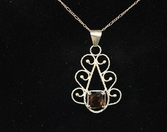 REDUCED!!! Faceted Smokey Quartz Pendant set in Sterling Silver.