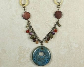 Blue/Green ceramic pendant with wood, bone, and metal necklace