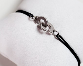 Handcuff bracelet in white gold 750 guarantees the originality with black jade cord