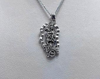 CORSE pendant the Virgin and Child