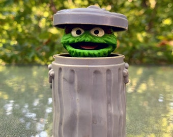 1985 Spring Loaded Sesame Street Oscar the Grouch in Trash Can Toy