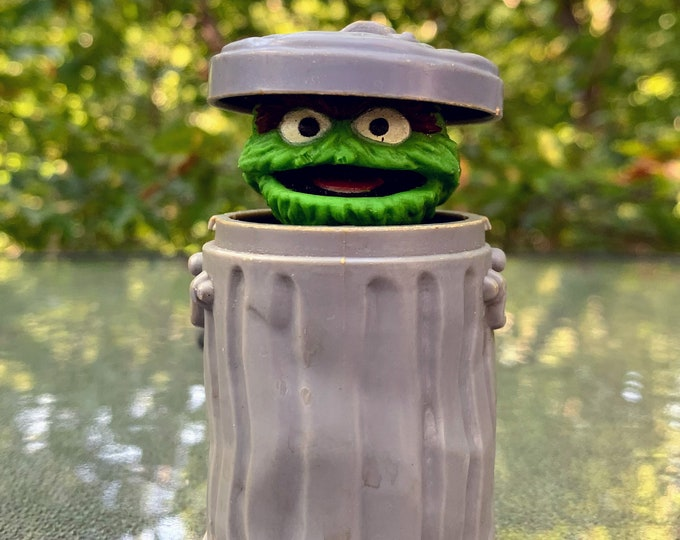 Featured listing image: 1985 Spring Loaded Sesame Street Oscar the Grouch in Trash Can Toy