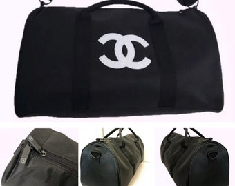 ec2a6db6f68f Chanel Black with White CC Emblem Tote Gym Bag Barrel Shape CHANEL Logo on  Handle CC on Zipper Pulls Party Favor Gift or Gift Bag