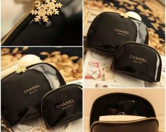 621730603814 CHANEL June PREVIEW *Reserve* Black Patent Leather Cosmetic Bag Two Gold  Snowflake Zipper Pulls CC Emblem Medium of 3 sizes 9.5 x 6 x 2