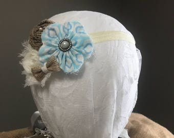 Blue and brown flower headband with cream elastic band