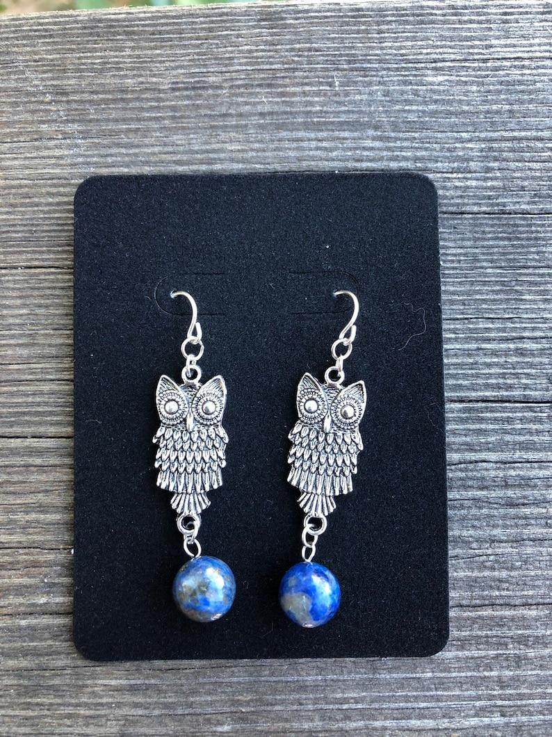Owls carrying Lapis Gemstones