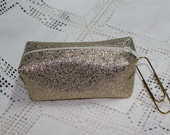Glittery gold glitter faux make-up pouch and a giant paper clip