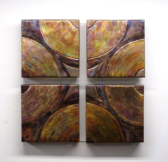 Flame painting on copper wall panel. An acrylic support for four paintings