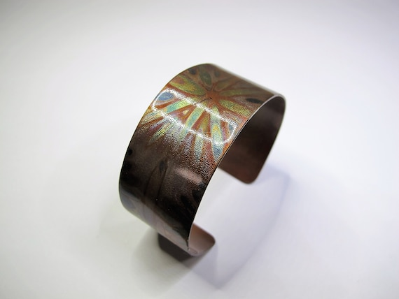Copper Bracelet flame painted with Swarovski crystal. The cuff is flame painted with a torch and covered by a protective coat