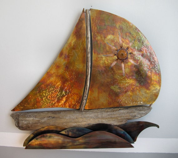 Wall sculpture made of copper and driftwood. Sails and waves are made of copper and are colored with the blowtorch. Polyurethane finish.