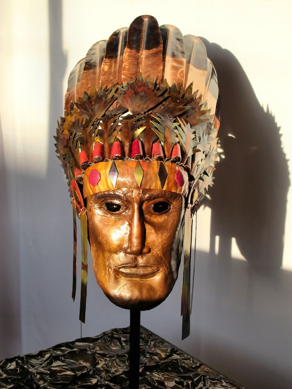 Flame painted copper sculpture. Indian chief with ceremonial headdress