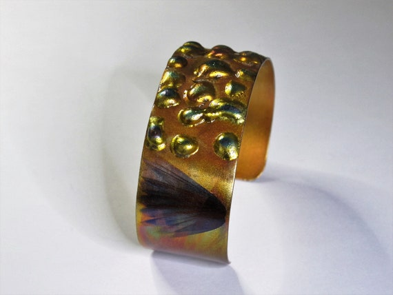 Copper Bracelet flame painted, yellow hue. The cuff is flame painted with a torch and covered by a protective coat, fire painting,