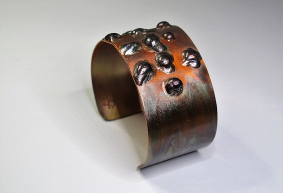 Copper Bracelet. The cuff is flame painted with a jewelry torch and covered by a protective coat, flame paint copper, adjustable