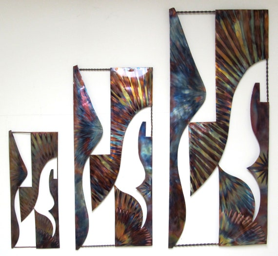 Copper wall art panels. A mixture of abstract and figurative art where I see  flying horses. The copper was flame painted.
