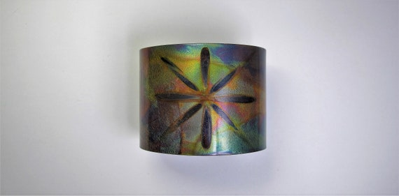 Copper Bracelet flame painted. The cuff is flame painted with a torch and covered by a protective coat