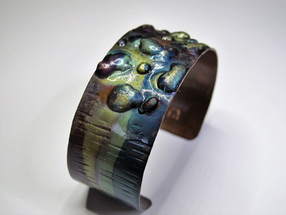 Copper Bracelet flame painted, blue and green colors. The cuff is flame painted with a torch and covered by a protective coat
